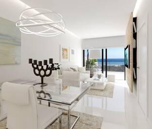 det-ljusa-vardagsrummet-med-naturligt-ljus-frran-terrassen-med-makalosa-vyer-och-havsutsikt--899440962-rszww1170-80