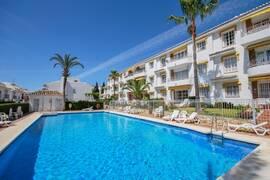 PRISSÄNKT: Lägenhet med stor terrass i populära området Mijas Playa Club